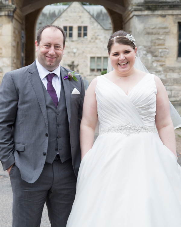 Bride and Groom with their hands in their pockets at Thoresby Courtyard wedding