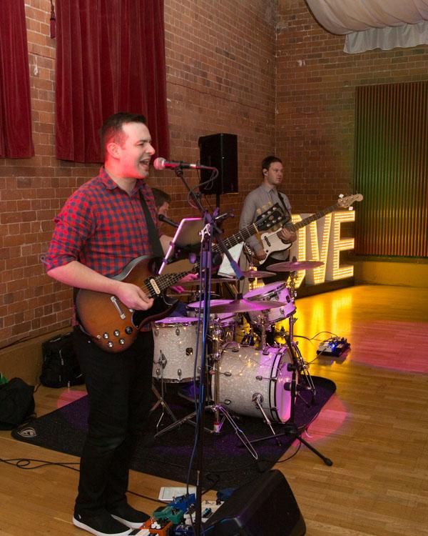 Livbe band the kickstarts playing at Thoresby Courtyard wedding