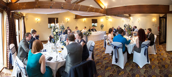 Room of geausts seated for the wedding breakfast at Tankersley Manor Hotel Barnlsey