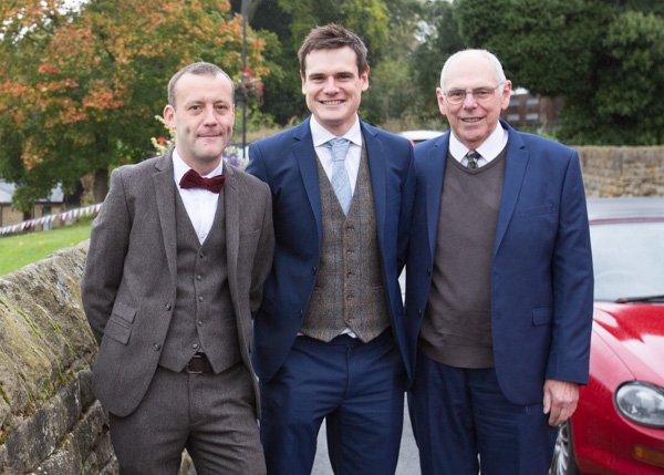 Groom best man and father of the groom outside Bradfield village hall on the wedding morning