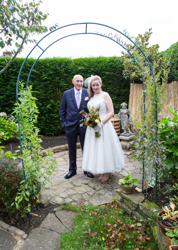 Bride and Father of the Bride in their garden on the morning of the wedding