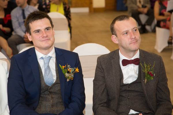 Groom and Best man watching the string quartet at Bradfield Village Hall