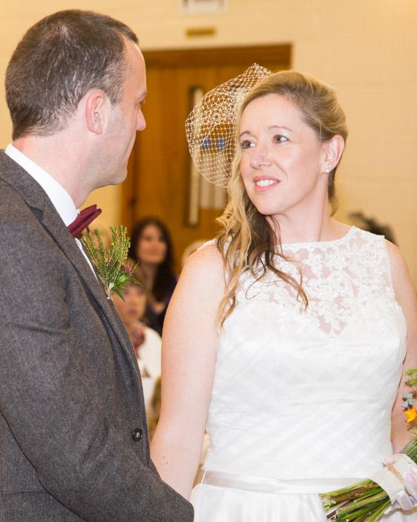 Bride and Groom at trhe alter at Bradfield Viallge Hall wedding