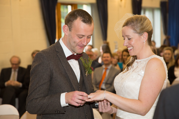 BRide and Greoom exchanging rings at Bradfield Village Hall weding