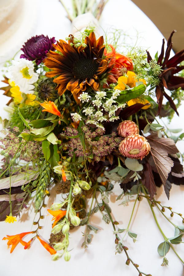 Burnt orange sunflower in bridal bouquet autumn wedding colours