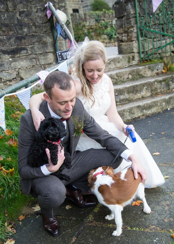 Bride and Groom with their two dogs on their wedding day