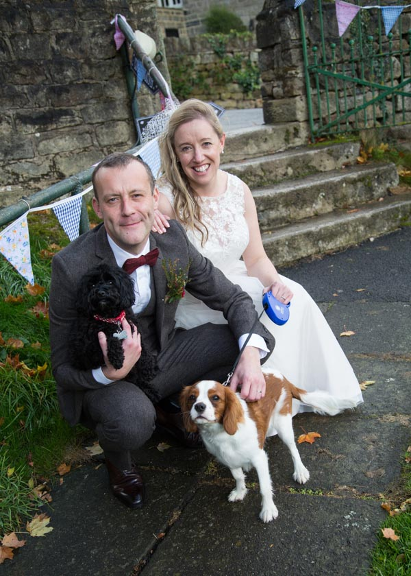 Bride and Groom with their two dogs outside Bradfield Village Hall