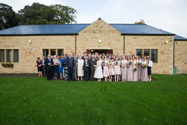 All guests outside Bradfield Village Hall wedding day