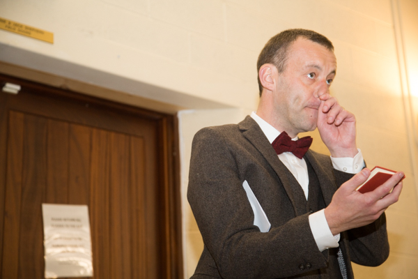Groom reading advice for marriage during his speech