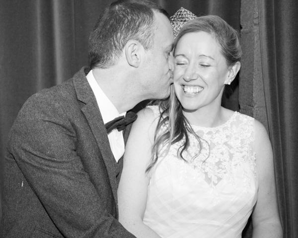 Groom Kissing bride ont he cheek