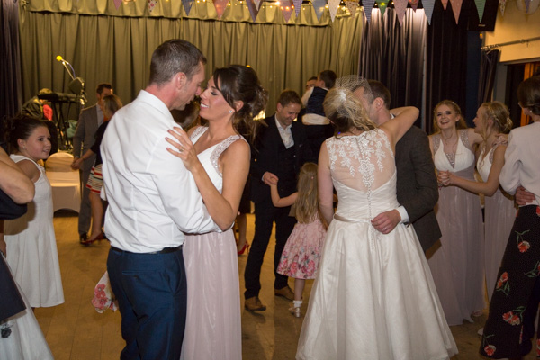 Guests dancing with bride and groom at Bradfield Village Hall