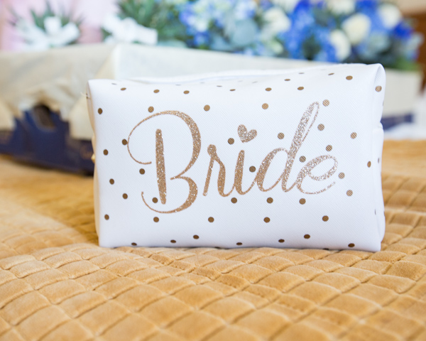 Make up bag with Bride written across it in gold sparkle