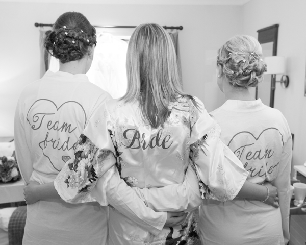 Bridesmaids and Bride in matching dressing gowns team bride