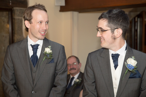 Groom and Best Man smiling and waiting in the ceremony room at Tankersley Manor