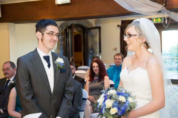 Bride and Groom at their wedding ceremony smiling width=