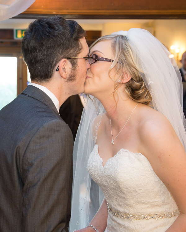 Bride and Groom kiss at the end of their wedding ceremony at Tankersley Manor