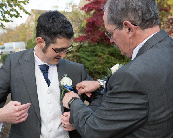 Father of the Groom sorting out Grooms button hole