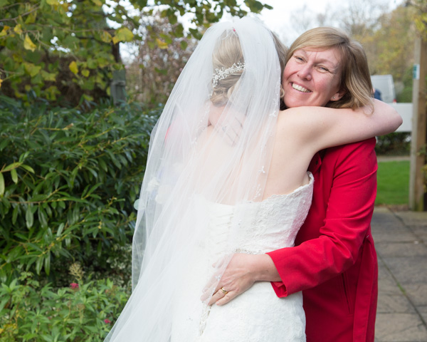 Bride hugging a wedding guest