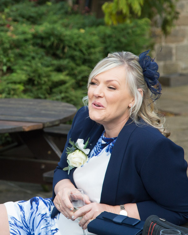 Mother of the Bride sitting at a bench at Tankersley Manor hotel