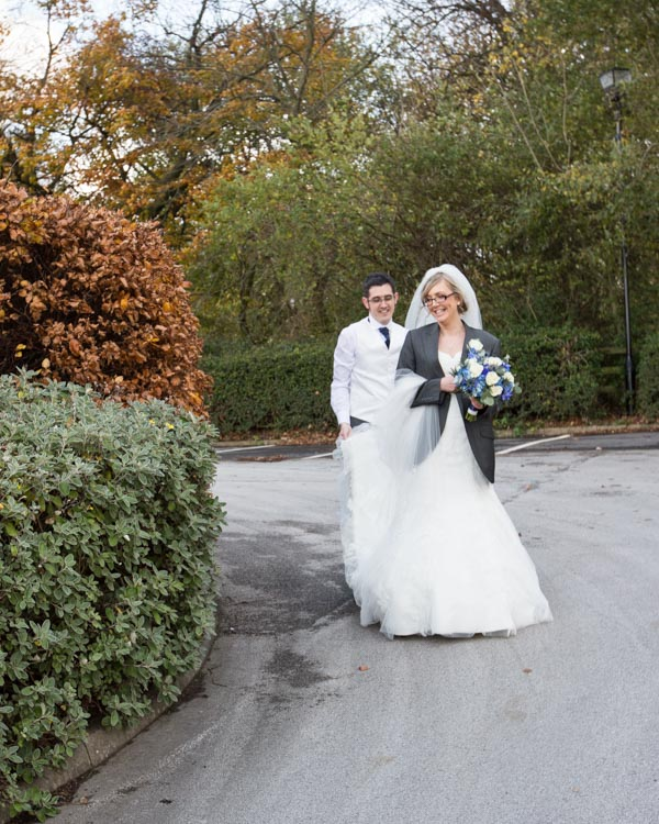 Bride wearing Grooms jacket at Tankersley Manor Hotel
