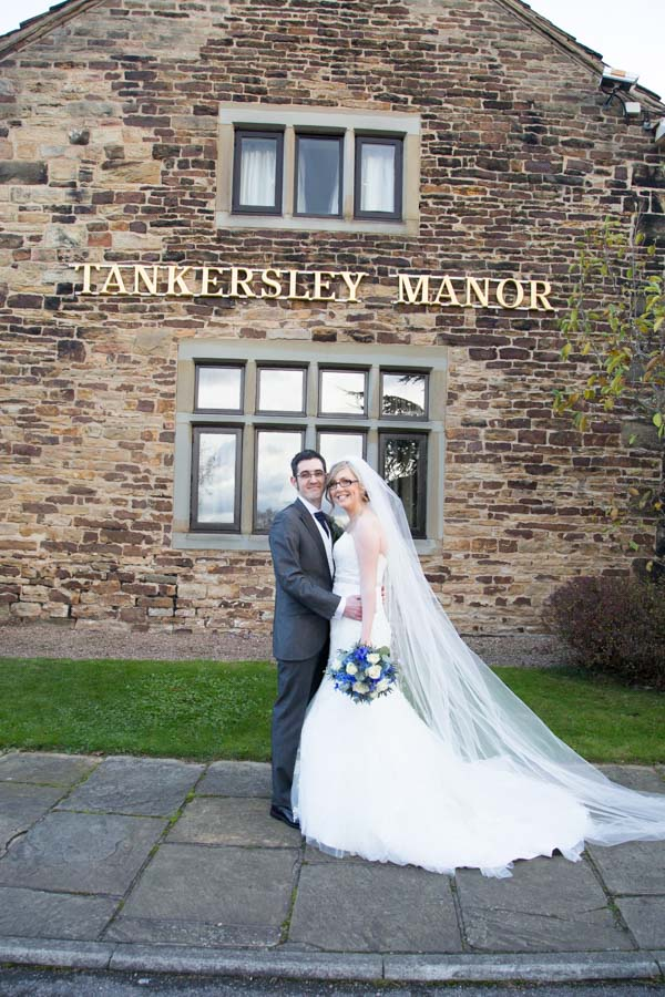 Bride and Groom outside Tankersley Manor Hotel sign