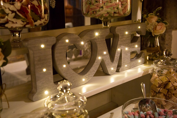 Love sign lit up on sweet cart