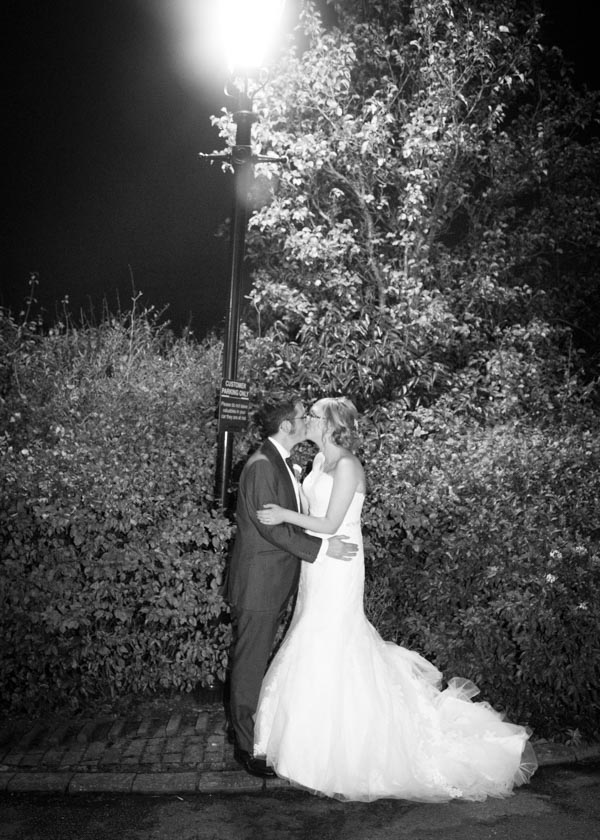 Bride and groom in Tankersley Manor grounds at night