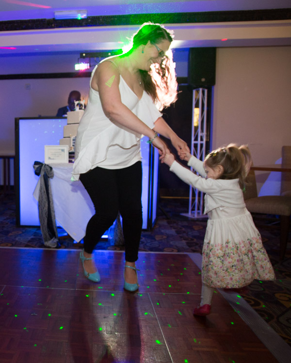 Mother and Daughter dfancing at a wedding