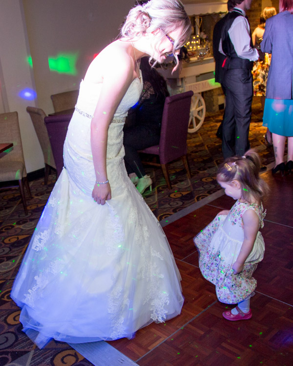 Bride showing her dress to a toddler