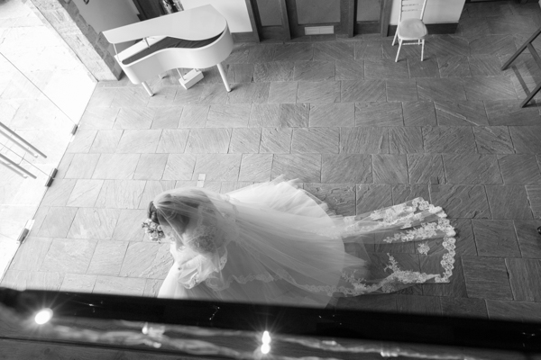 Bride walking to the wedding ceremony room at Priory Barn and cottages Wetherby