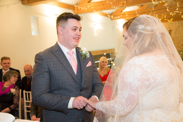 Exchange of the rings during the priory barn and cottages wedding