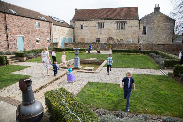 Children playing in the courtyard at Priory Barn and Cottages