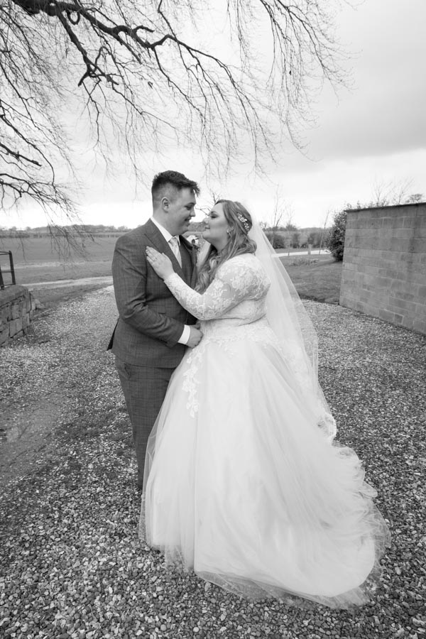 Bride and Groom outside Priory Barn and cottages