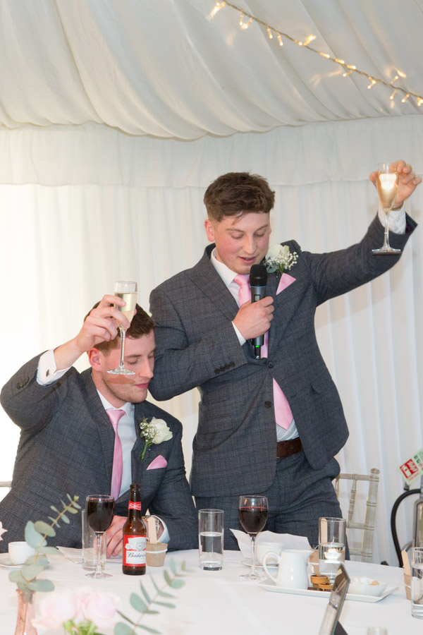 Best men raising a toast