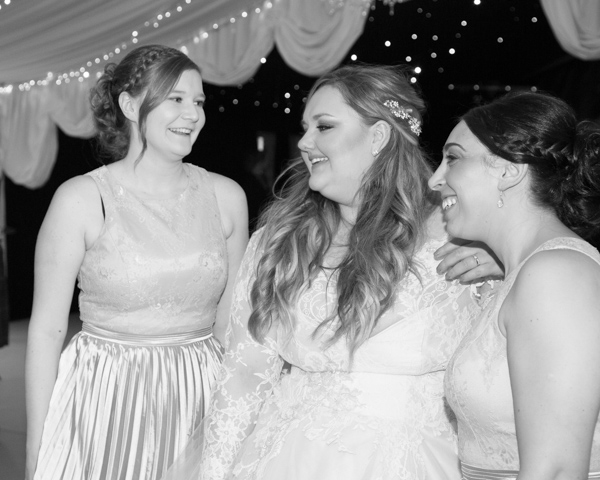 Bride with her bridesmaids during the evening reception