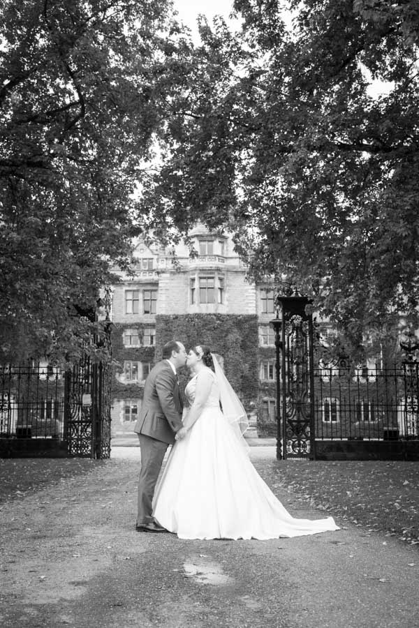 Bride and Groom kissing outside Thoresby Hall on their wedding day