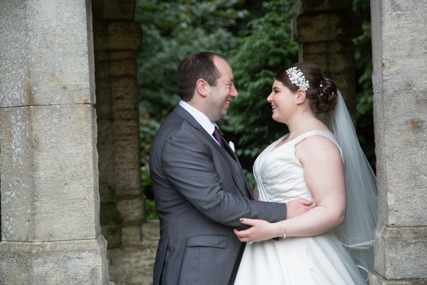 Bride and groom looking at each other and smiling at Thoresby Hall wedding