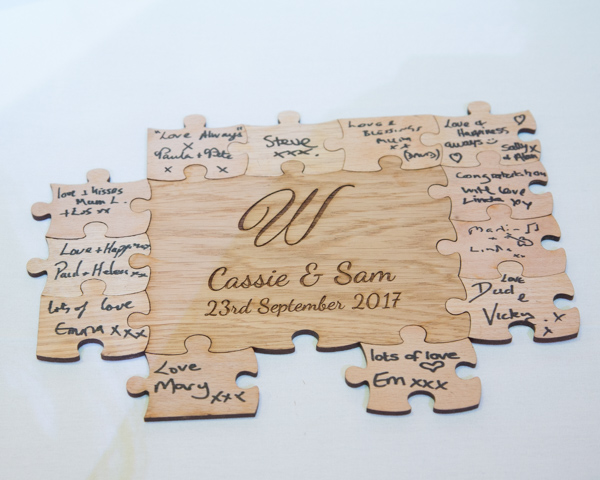 Jigsaw wedding guest book personalised with bride and groom names and wedding date Thoresby Courtyard Wedding