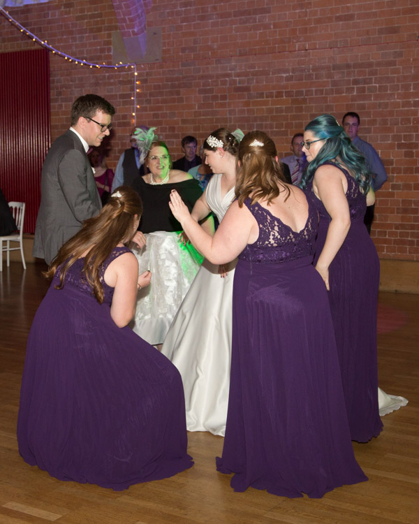 Bridal party dancing to the live music at thoresby courtyard wedding