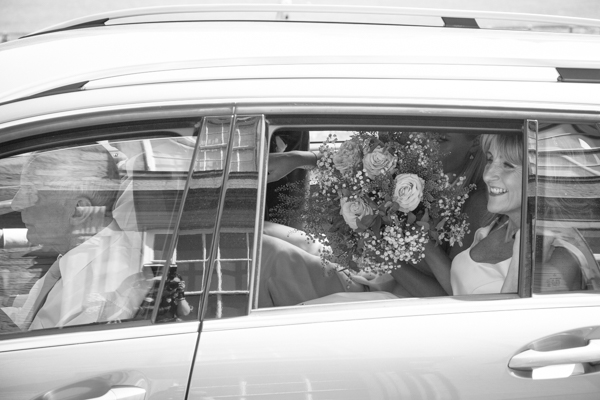 Bride, Father and Bridesmaid in car on way to venue