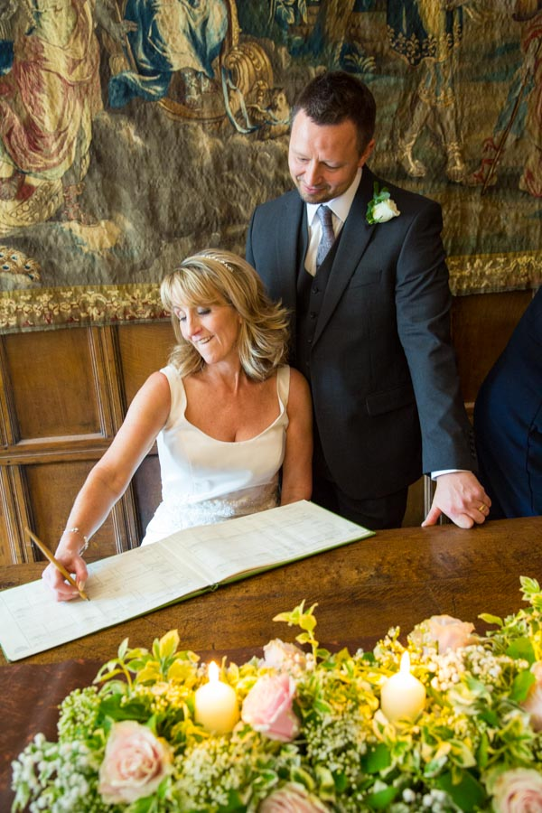 Bride and groom signing the register at Cannon Hall wedding