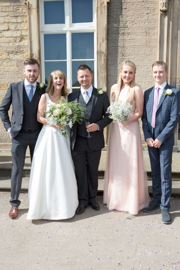 Bride, Groom and their children smiling after the wedding at Cannon hall