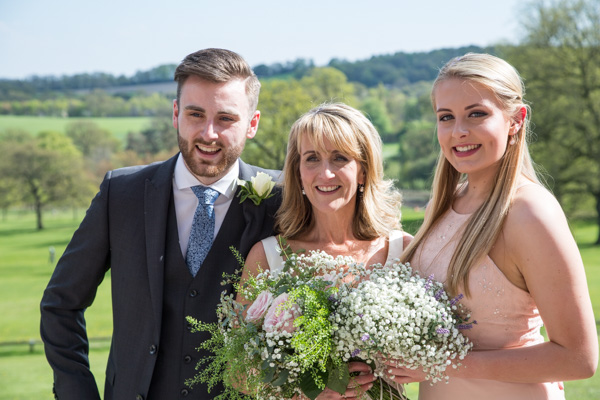 Bride bridesmaid and son smiling int he grounds of Cannon Hall on their wedding day
