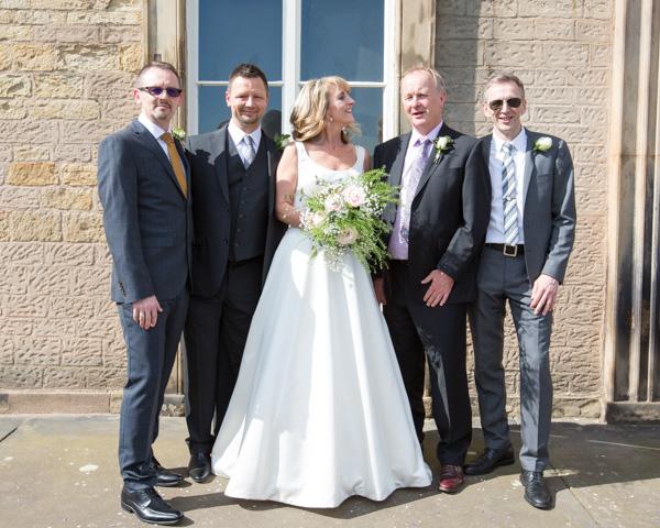 Bride and groom and their brothers on their wedding day at Cannon Hall