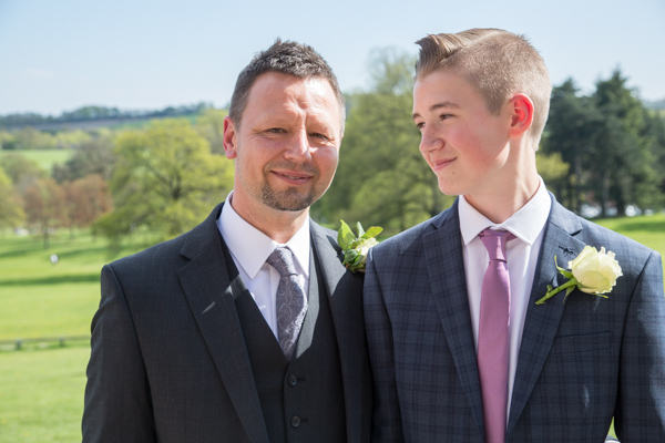 Groom and his son smiling at Cannon Hall on his wedding day