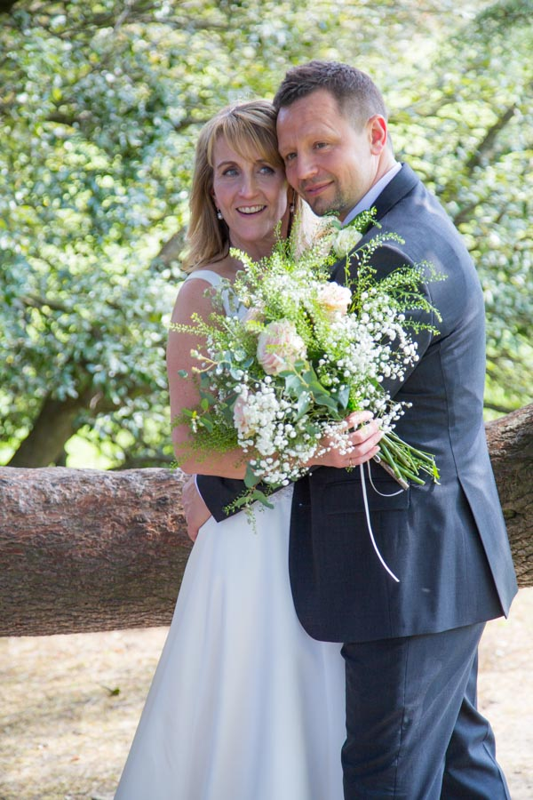 Bride and Groom smiling at Cannon Hall on their wedding day