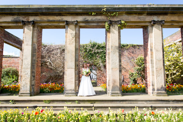 Bride and Groom in the walled garden at Cannon Hall