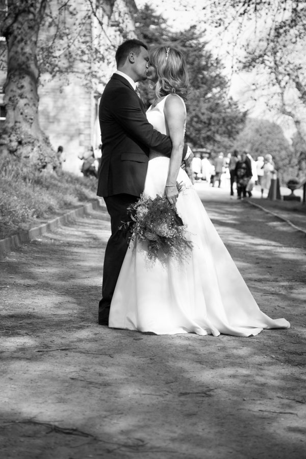 Bride and Groom kiss outside Cannon Hall in black and white