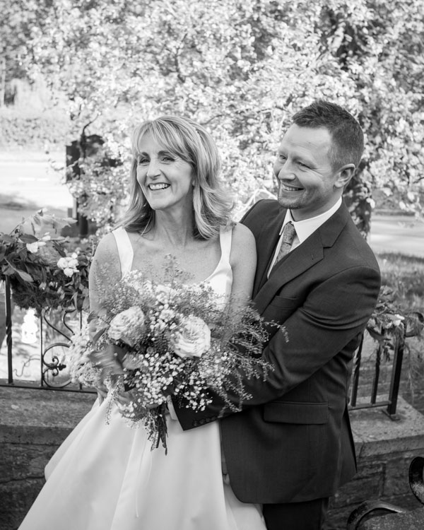 Bride and Groom laughing on the steps of Cawthorne Village hall