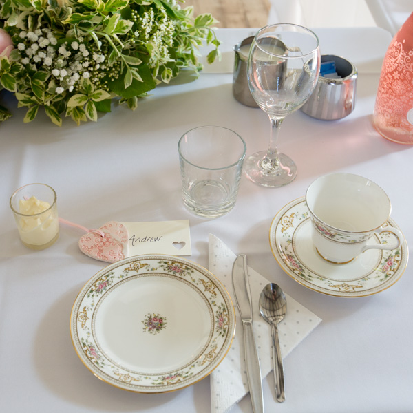Cutlery and crockery on wedding breakfast table with name tag